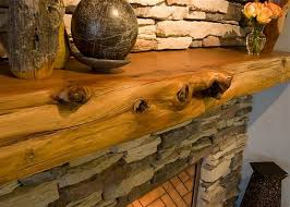 rustic wood and stacked stone fireplace mantels decorating