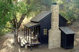 Small bunkie with front porch and stone fireplace
