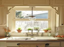 kitchen window above sink light fixture with nature and rustic accent
