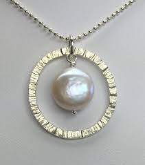 round hammered silver circle with pearl pendant