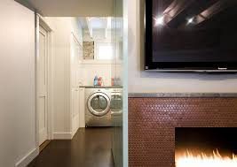 view in gallery copper penny tiles bring the fireplace alive with a metallic glint design e