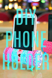 easy diy phone holder made from toilet paper rolls covered in colorful washi tape and supported