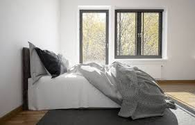 modern bed side view. Beautiful Side 3d Rendering Of An Unmade Messy Bed In A Modern Bedroom With Balcony Door  And Window On Modern Bed Side View E