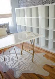 ikea office design ideas. desk is ikea high gloss linnmon tabletop in white trestle legs spray painted gold and expedit shelving office design ideas
