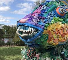 garden art. Priscilla The Parrot Fish Is Made Out Of Plastic Toys, Buoys, Toothbrushes And Other Garden Art