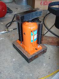 here is my mini hydraulic knife forging press made from an air operated bottle jack