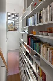 Contemporary slat bookshelf staircase with private views of Brooklyn's  Boerum Hill neighborhood. - By Sarah