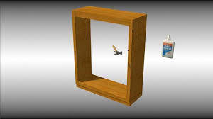 attach 1 x 2 trim pieces to the side and bottom edges of the bookshelf with sixpenny nails and glue
