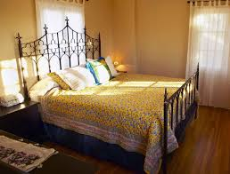 wrought iron bedroom furniture. Bedroom : Furniture Antique Wrought Iron Beds And Yellow Floral Pattern Bed Cover Also Sleigh Frame Amusing Frames Design Ideas
