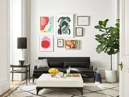 gallery wall of Kate Spade art