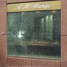 bulletproof glass of a jeweler s window after a burglary attempt