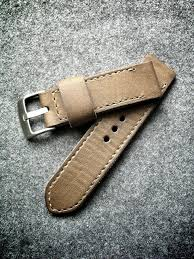 a deep saddle tan russet color this handmade cow leather strap is 4mm thick features smooth darkened sides pointed tail