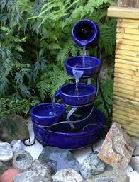 Tiered SolarPowered Water Fountain U2013 SerenityHealthSolar Water Features With Lights