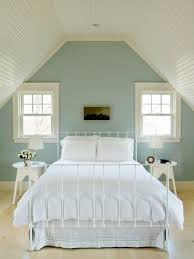 relaxing bedroom ideas. coastal light wood floor and beige bedroom photo in providence with blue walls relaxing ideas