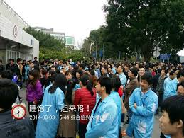 many people carried signs and banners while at one time they also sang the chinese national anthem