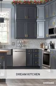 black cabinet pulls on gray cabinets. our sleek stainless steel appliances come to life when set against rich gray cabinets with bold gold hardware. love the cabinet color. black pulls on