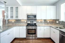 Installing A Glass Tile Backsplash Stunning Glass Tile Backsplashes White Glass Tile Great Modish White Kitchen