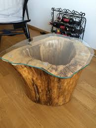 I made this coffee table with a lamp inside out of an old hollowed out tree  stump. stump by terry