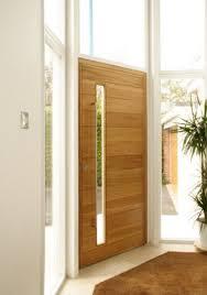 inside front door open. Light-colored Wood Door With A Vertical Glass Pane Inside Front Open