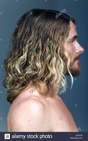 A Portrait Side Profile Of A Caucasian Male With Shoulder Length
