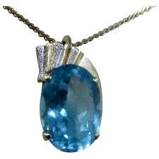 14k large swiss blue oval topaz pendant w enhancer 15 carats