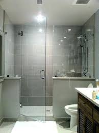 shower enclosure installed with clamps half wall panel
