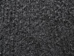 Background of black carpet pattern texture flooring Stock Photo