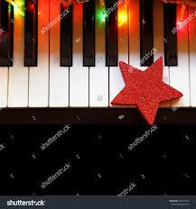 Piano Key Lights Christmas Lights Ornament On Piano Keys Stock Photo Edit