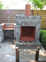 decorate cinder block concrete foundation and set posts for benches layed cinder block outdoor fireplace