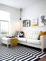 black and white striped area rug for small living room furniture arrangement ideas with elegant tufted sofa using yellow toss pillows