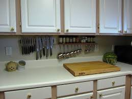 Inspiring Kitchen Storage Ideas with Utensil Holders and White Cabinet