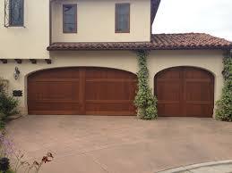 garage doors san diegoCustom Wood stain grade sectional garage doors installed in San