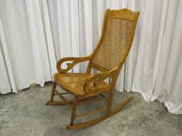 description we have for an extra nice antique bentwood rocker with cane seat and