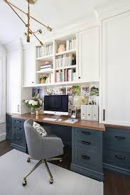 office blue. pretty sure this is my dream office love the dark blue gray lower desk cabinets i