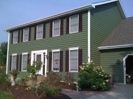 Exterior Painting - Green two story traditional home with white trim.  traditional-exterior