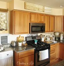Decor Over Kitchen Cabinets Kitchen Above Kitchen Cabinet Arrangements Decorating Ideas