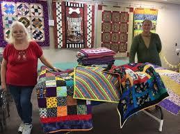 Ozark Piecemakers contribute 120 children's quilts to SPD &  Adamdwight.com