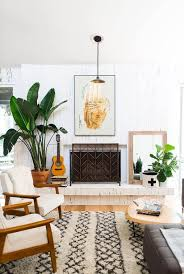 white marble ethanol fireplace vanilla linen fiber arm chair beige diamond area rug triangle wooden coffee table classic guitar wooden base floor stand