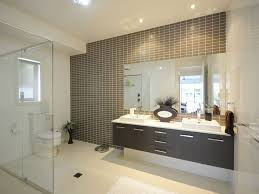 narrow bathroom window with double sinks wall mounted bathroom vanity under frameless mirror and recessed