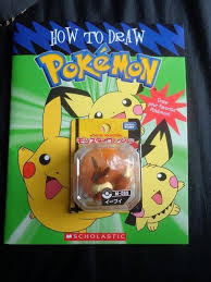 how to draw pokemon book and an eevee figure pokemon exchange redditgifts