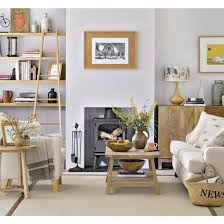 mix mid century style pieces with contemporary furniture in unfinished wood and plain upholstery for an unfussy rustic look un arranged displays of unusual