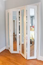 pretty closet doors with mirrors and glass doorknobs make the bedroom look larger