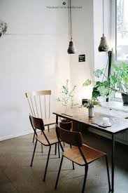 simple white dining e with plants
