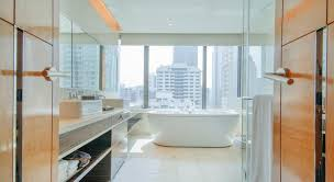 the deluxe room also offers a sensational bubble bath experience with a nicely sized bathtub placed right by the large glass window so you get to enjoy