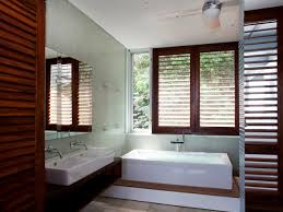 contemporary bathroom with wood plantation shutters