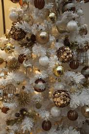 vintage-inspired gold ornaments in a faux white tree