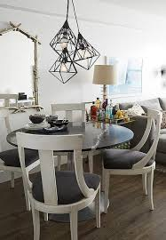 round black dining table with white dining chairs