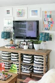 Tv stand decor Ikea How To Decorate Around Television Home Stories To Tips For Decorating Around Television