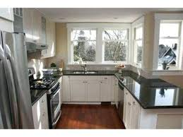 painted kitchen cabinets with dark granite countertops blue grey painted