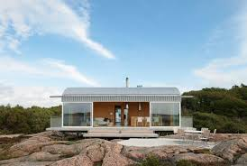 19 Examples Of Modern Scandinavian House Designs | Large glass windows make  up the front of